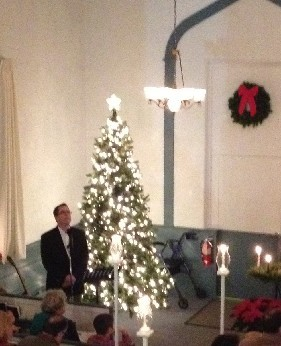 Alec Rogers singing O Holy Night at a Christmas Eve Service